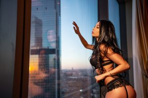 Young sexy girl in lingerie by the window
